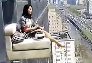 ledge [Video] Woman Sitting Outside Her 23rd Story Window Funny Picture