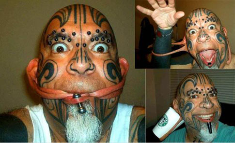 A man with tattoos who does strange things