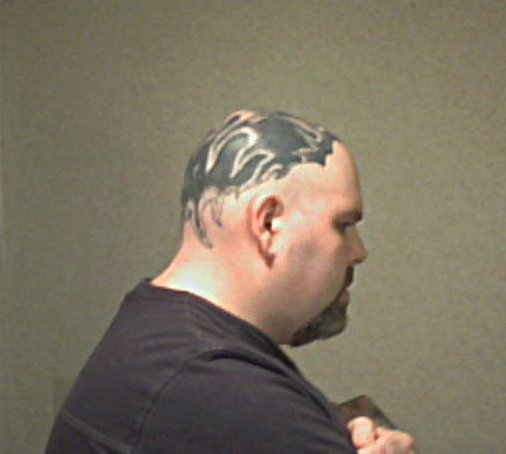 Side view of my tattooed head
