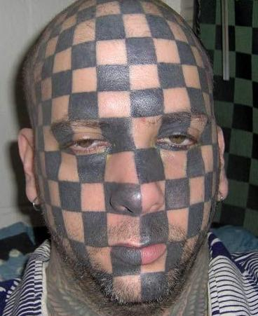 http://media.ebaumsworld.com/picture/morningglory13/checkerboard_face_tattoo.JPG